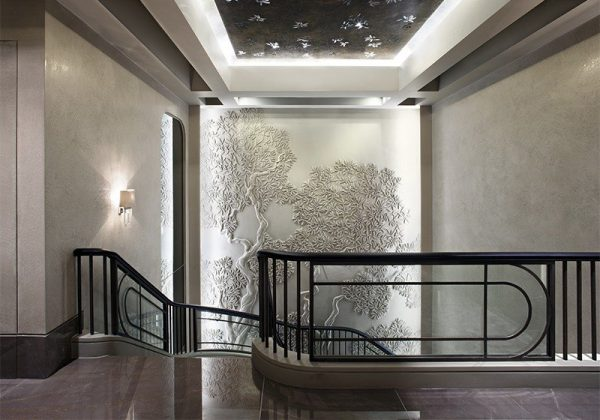 Stylised, hand-carved staircase bas relief. Photography by James Silverman. Interior design by Rene Dekker with SHH Architects