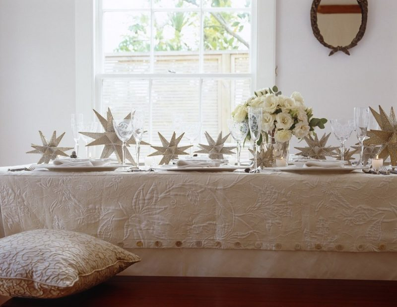 A length of taffeta with a textured over cloth create a traditional yet modern Christmas table.