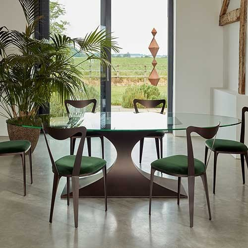 Tom Faulkner Capricorn-dining-table-with-Tiffany-chairs