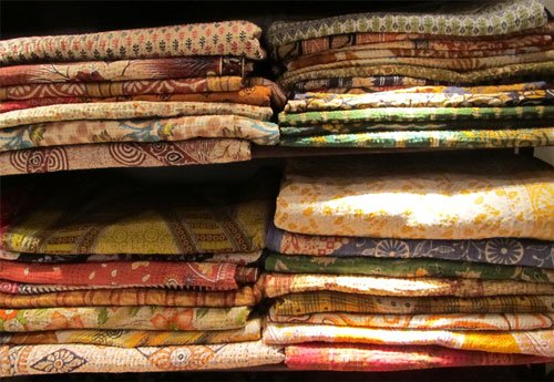 Hand-printed sari bedspreads at Guinevere