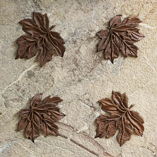 limestone with inlaid leaves from Lapicida